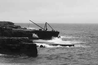 Waves breaking on a portland...